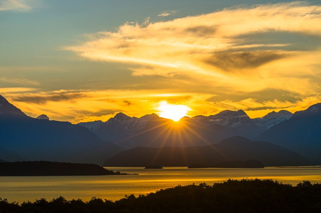 The sun sets over Manapouri